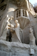 The Passion facade shows various scenes from Jesus's death in very modern, austere style. Here, Pontius Pilate washes his hands as his wife walks away.