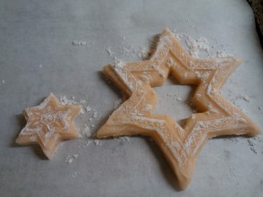 You can cut out the insides of stars and wreaths with smaller cookie cutters
